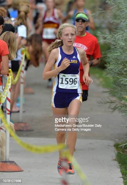 Boulder's Claudia Burgess running in the Centaurus Invitational Cross Country meet at Waneka Lake in Lafayette