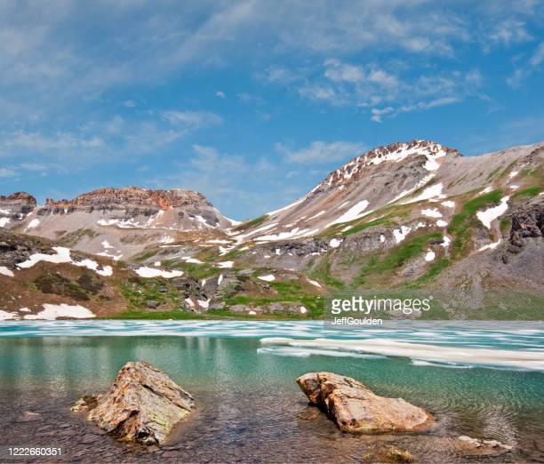 boulders in upper ice lake - jeff goulden stock pictures, royalty-free photos & images