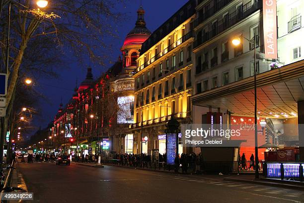boulevard haussmann for christmas in front of two departments stores, au printemps and galleries lafayette - galeries lafayette paris stock photos and pictures