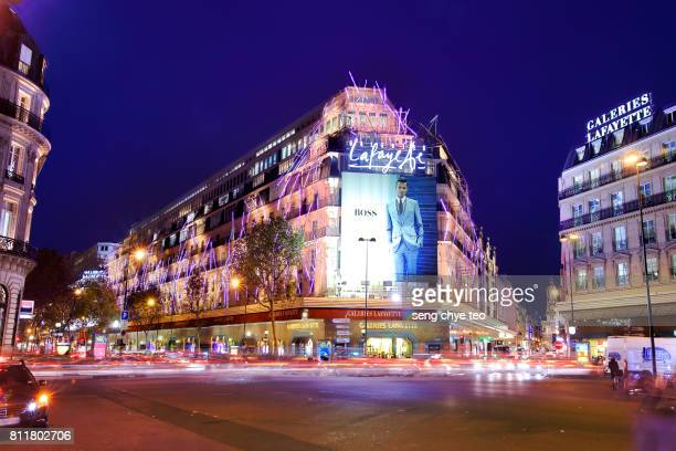 boulevard (street) haussmann, lafayette galleries - galeries lafayette paris stock photos and pictures