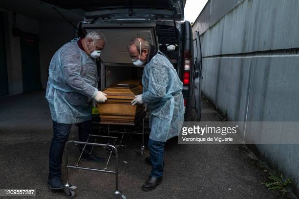 Bouli and Alain, undertakers, arrive at nursing home to retrieve two bodies of elderly people who died overnight from coronavirus on April 5, 2020 in...
