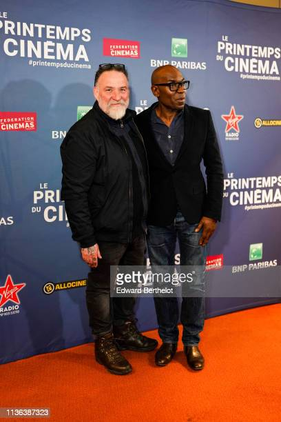 Bouli Lanners and Lucien JeanBaptiste attend the 20th 'Le Printemps Du Cinema' Photocall At UGC Cine Cite Bercy on March 17 2019 in Paris France