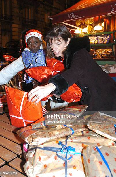 Burundian Princess Esther Kamatari gathers gifts to offer during a Christmas eve celebration for poor people 24 December 2005 in BoulogneBillancourt...