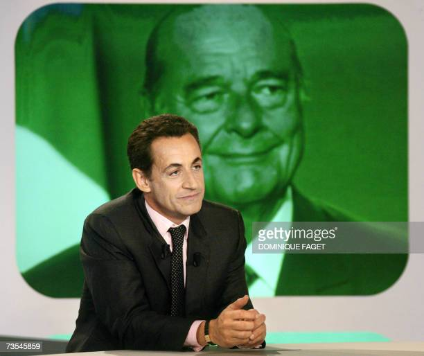 French rightwing candidate for the presidency Interior Minister Nicolas Sarkozy sits on the set of the Canal tv show Dimanche plus in front of a...