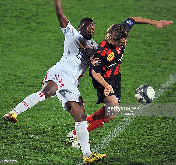 Boulogne's French defender Marc Damien vies with Nancy's forward Paul Aloo Efoulou during their French L1 football match BoulognesurMer vs Nancy on...