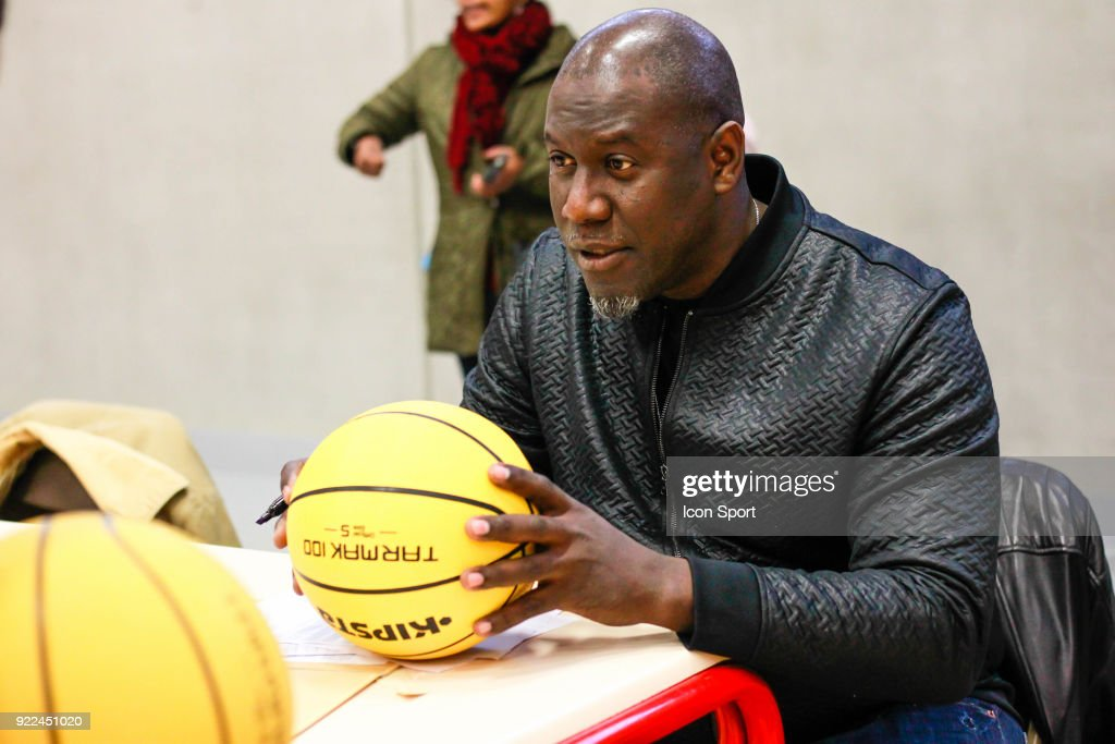 Bouna Ndiaye sign a ball for the kids during come to explain the project younus at Grigny, France on 7th February 2018