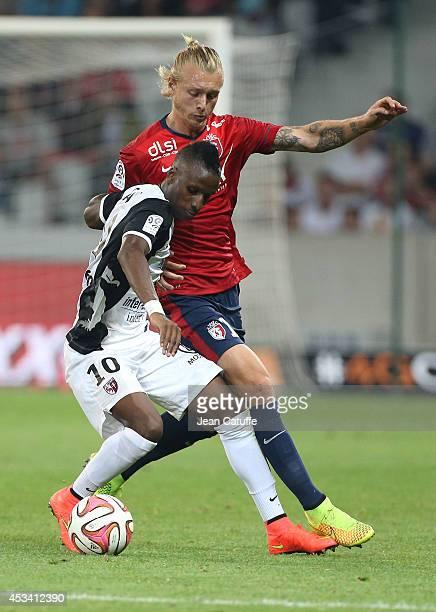 Bouna Saar of FC Metz and Simon Kjaer of Lille in action during the French Ligue 1 match between LOSC Lille and FC Metz at the Grand Stade Pierre...