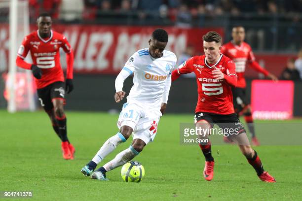 Bouna Sarr of Marseille and Adrien Hunou of Rennes during the Ligue 1 match between Rennes and Marseille at Roazhon Park on January 13 2018 in Rennes...