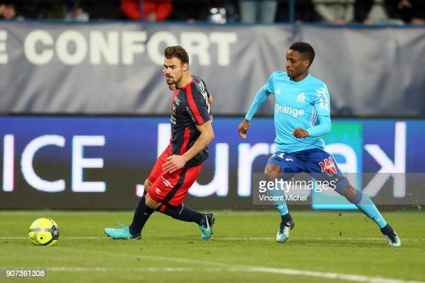 Bouna Sarr of Marseille and Damien Da Silva of Caen during the Ligue 1 match between Caen and Olympique de Marseille at Stade Michel D'Ornano on...