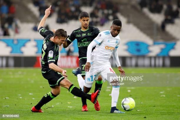 Bouna Sarr of Marseille and Franck Tabanou of Guingamp during the Ligue 1 match between Olympique Marseille and EA Guingamp at Stade Velodrome on...