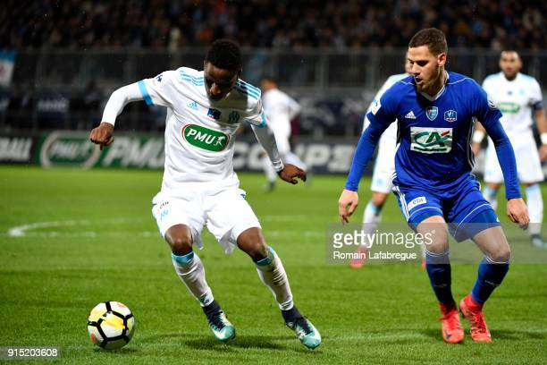Bouna Sarr of Marseille and Jordan PierreCharles of BrougenBresse during the French National Cup match between Bourg en Bresse and Marseille on...