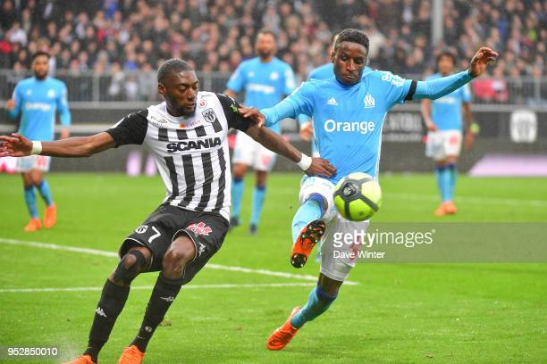 Bouna Sarr of Marseille and Karl Toko Ekambi of Angers during the Ligue 1 match between Angers SCO and Olympique Marseille at Stade Raymond Kopa on...