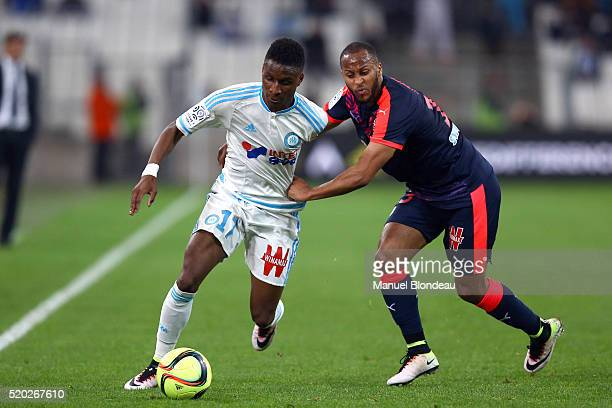 Bouna Sarr of Marseille and Thomas Toure of Bordeaux during the French League 1 match between Olympique de Marseille and FC Girondins de Bordeaux at...