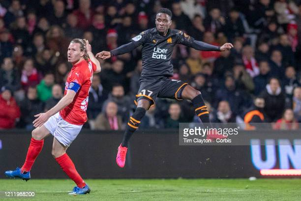 February 28: Bouna Sarr of Marseille shoots past Renaud Ripart of Nimes during the Nimes V Marseille, French Ligue 1, regular season match at Stade...