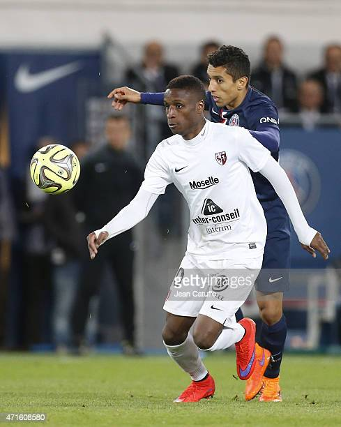 Bouna Sarr of Metz and Marquinhos of PSG in action during the French Ligue 1 match between Paris SaintGermain and FC Metz at Parc des Princes stadium...