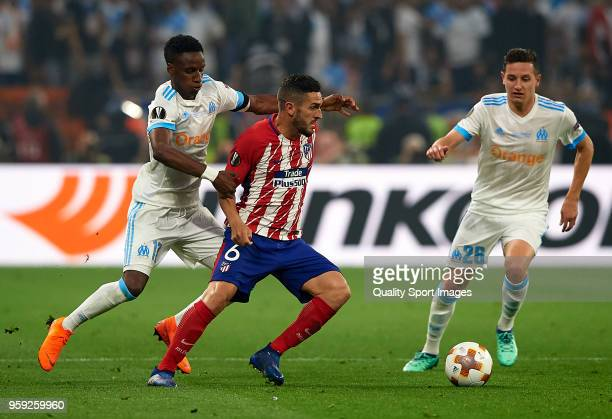 Bouna Sarr of Olympique de Marseille competes for the ball with Koke of Atletico de Madrid during the UEFA Europa League Final between Olympique de...