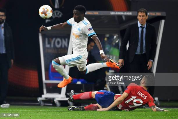 Bouna Sarr of Olympique Marseille is tackled by Lucas Hernandez of Atletico Madrid during the UEFA Europa League Final between Olympique de Marseille...