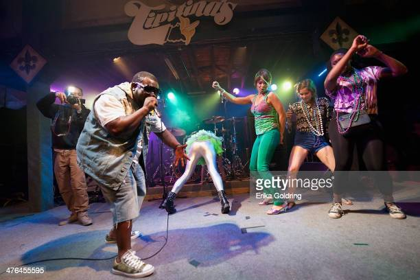 Bounce artist 5th Ward Weebie raps as women from the audience twerk at Tipitina's on March 2 2014 in New Orleans Louisiana