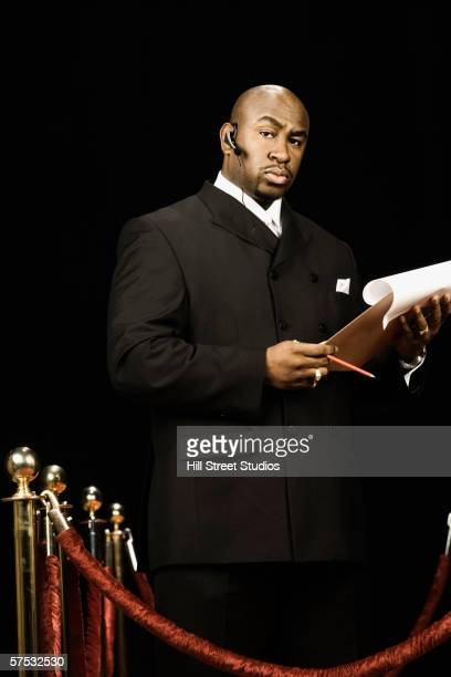 Bouncer holding a guest list