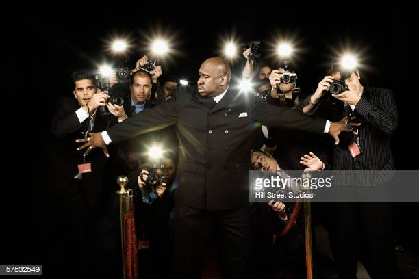 bouncer holding photographers back - doorman stock photos and pictures