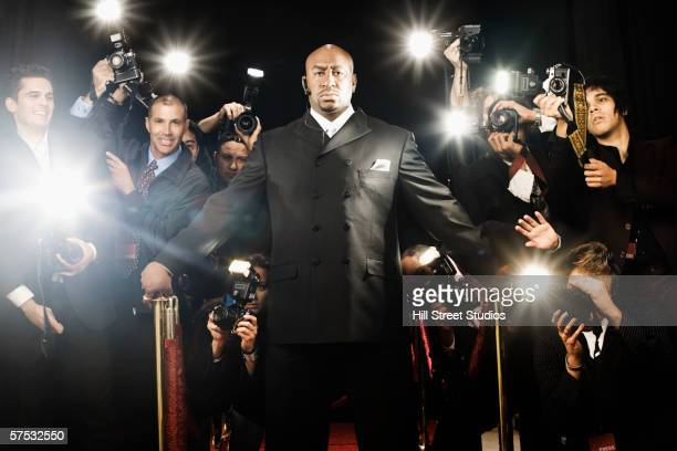 bouncer holding photographers back - bodyguard stock pictures, royalty-free photos & images