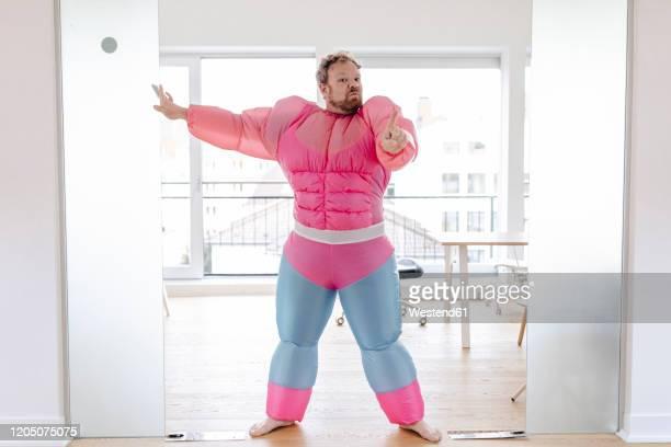 bouncer in office wearing pink bodybuilder costume - parte del cuerpo humano fotografías e imágenes de stock