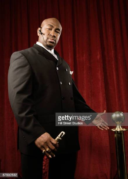 bouncer permitting entrance - bouncer security staff stock photos and pictures