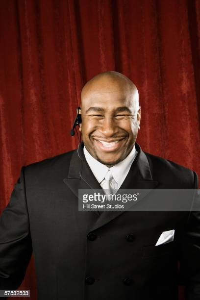 bouncer smiling - バウンサー ストックフォトと画像