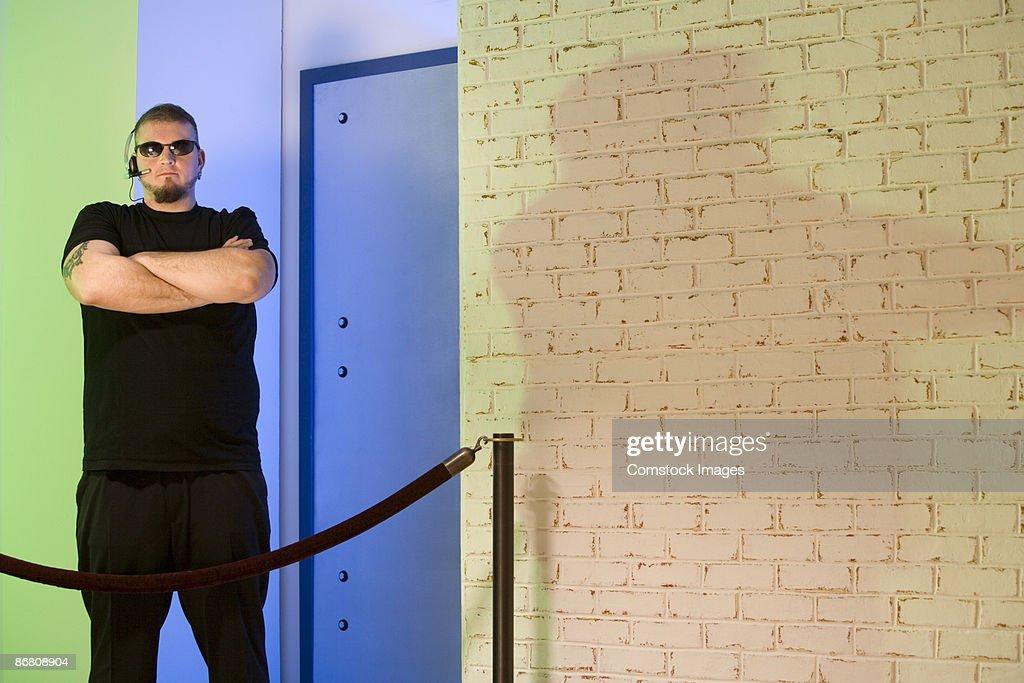 Bouncer standing outside nightclub : Stock Photo
