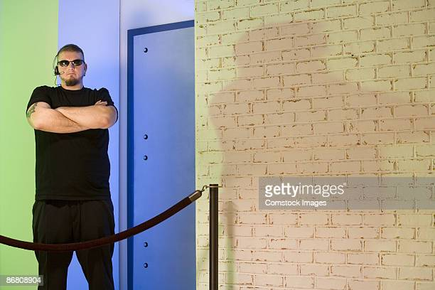 bouncer standing outside nightclub - bouncer security staff stock photos and pictures