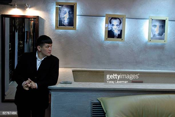 A bouncer stands in the entrance of Admiral Nelson nightclub before the striptease show Lady's Night starts on April 13 2005 in Almaty Kazakhstan The...