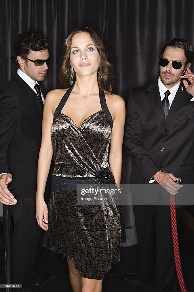 Bouncers admiring attractive woman : Stock Photo