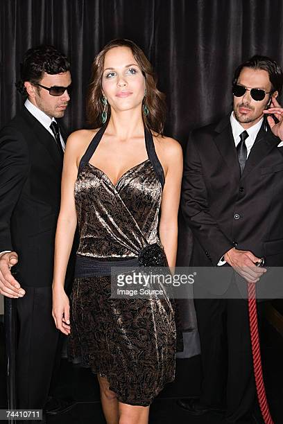 Bouncers admiring attractive woman