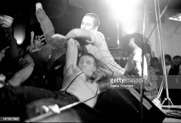 Bouncers keep fans of the stage while DRI performs at Medusas in Chicago Illinois USA on 11th June 1987