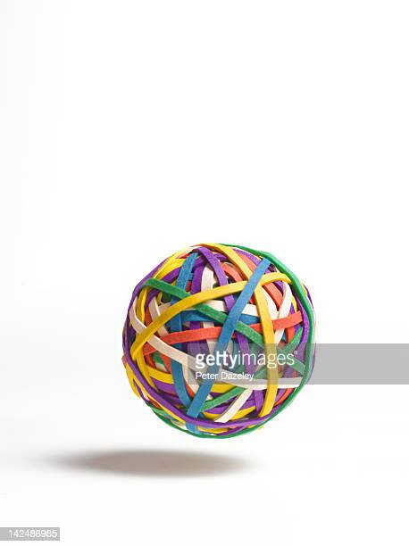 bouncing ball of elastic bands - bouncing ball stock photos and pictures