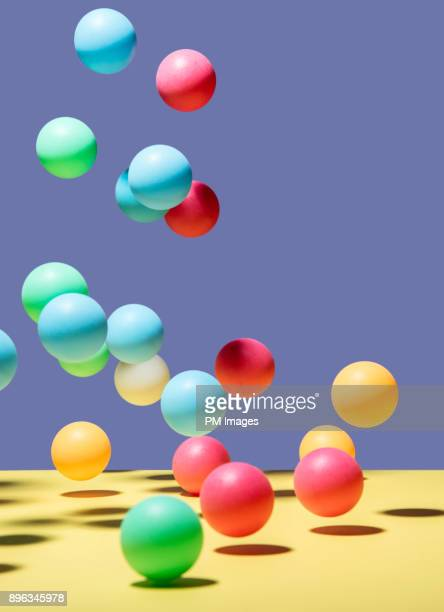 bouncing brightly colored balls - bouncing ball stock photos and pictures