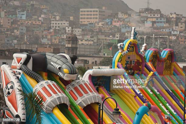 Bouncy Playground Equipment With Cityscape In Background