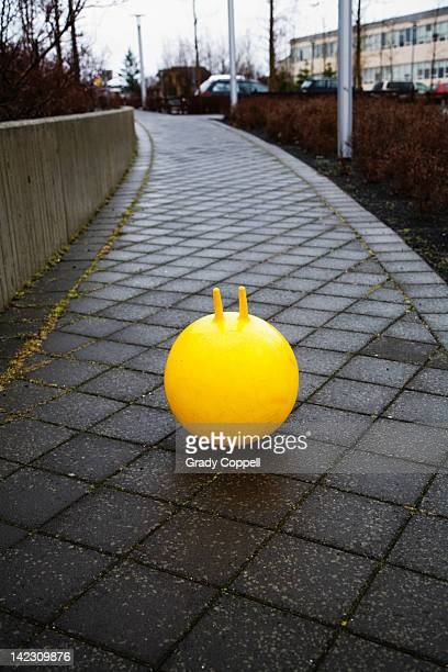 Bouncy toy on a footpath