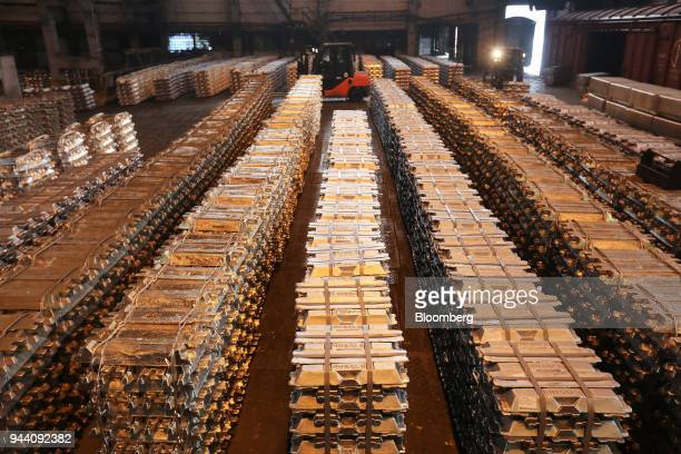 Bound aluminum ingots sit in a warehouse beside waiting freight wagons at the foundry in the Krasnoyarsk aluminum smelter operated by United Co Rusal...