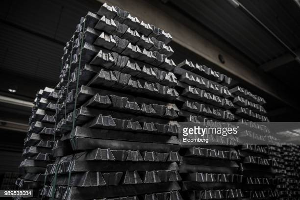 Bound aluminum ingots sit stacked in a warehouse ahead of shipping at the Alumetal Group Hungary Kft aluminium processing plant in Komarom Hungary on...