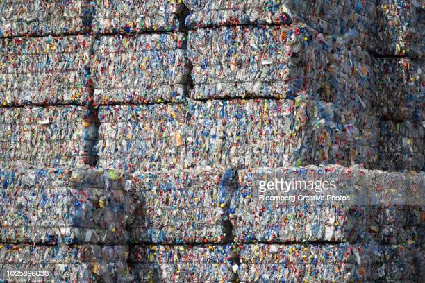 bound bales of crushed plastic bottles and containers - plastic stockfoto's en -beelden