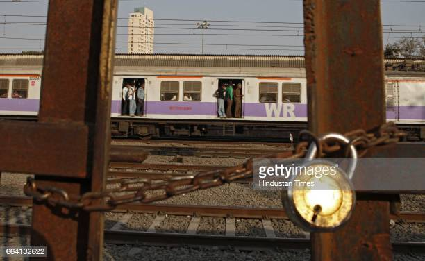 Bound by the increased train fares as announced in the Union railway Budgest commuters travel in a Mumbai local on Wednesday afternoon unaware of...