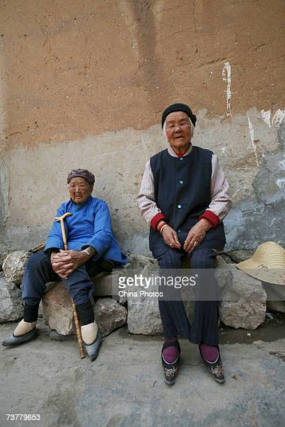 Bound feet women chat at Liuyi Village on April 2 2007 in Tonghai County of Yunnan Province China Liuyi Village is known as the Bound Feet Women...