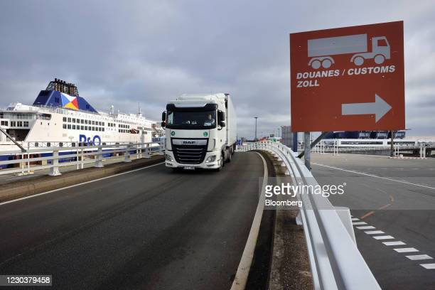 Bound haulage truck drives near the customs area at the Port of Calais in Calais, France, on Friday, Jan. 1, 2021. The U.K. Completed its divorce...