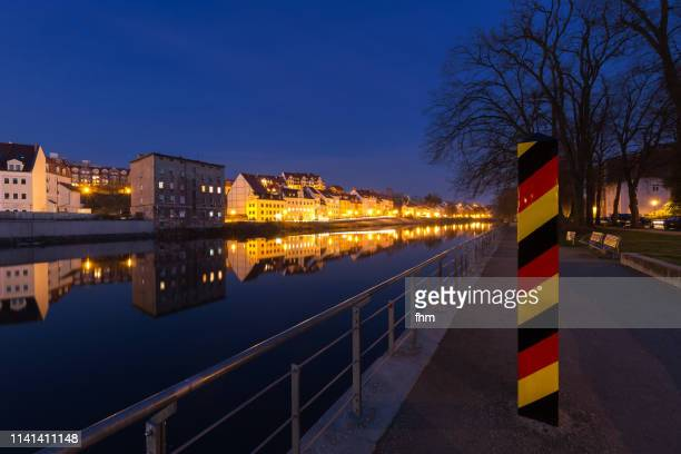 boundary post in görlitz at blue hour (saxony, germany) - german culture stock pictures, royalty-free photos & images