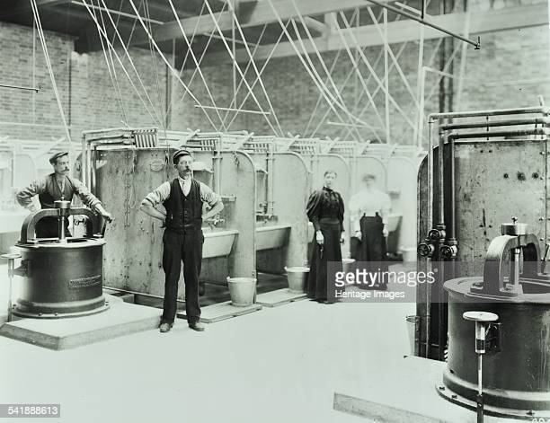 Boundary Street Area Laundry Bethnal Green London 1897 Staff are shown in the laundry surrounded by large sinks and presses Artist unknown