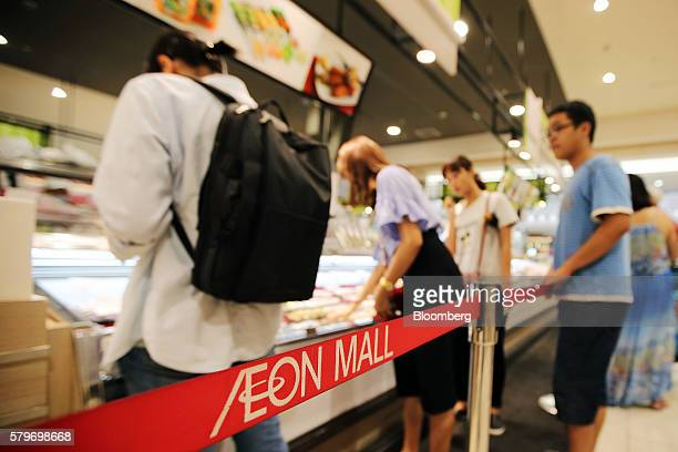 Boundary tape stands near a sushi counter at the Aeon Co mall in the Long Bien district of Hanoi Vietnam on Thursday July 21 2016 With a young...