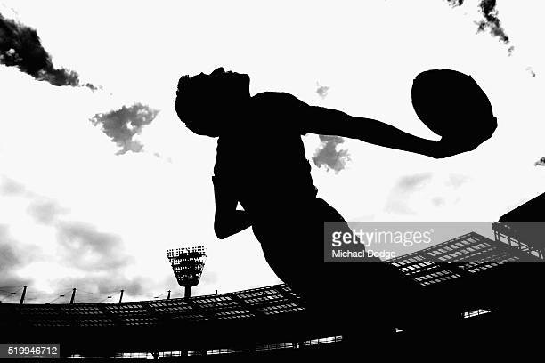 A boundary umpire throws a ball in the warm up during the round three AFL match between the St Kilda Saints and the Collingwood Magpies at Melbourne...
