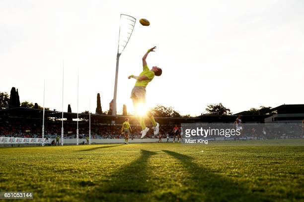 A boundary umpire throws the ball in during the JLT Community Series AFL match between the Greater Western Sydney Giants and the North Melbourne...
