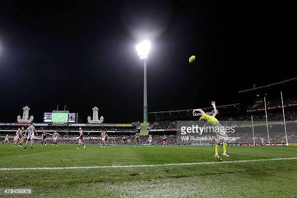 A boundary umpire throws the ball in during the round 13 AFL match between the Fremantle Dockers and the Collingwood Magpies at Domain Stadium on...